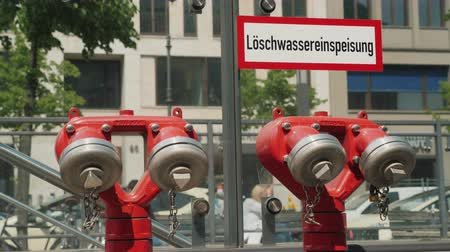 aeróbico : Berlin, Germany, May 2018: Red fire hydrant near the underground passage in Berlin
