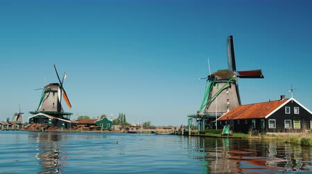 nizozemí : Scenic landscape in the Netherlands - Two old windmills on the river bank