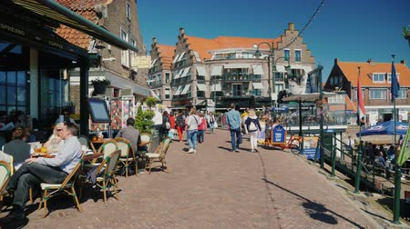 fishing village : Volendam, Netherlands, May 2018: Walking along the street of fishing village Volendam. Many tourists, souvenir shops and cafes Stock Footage