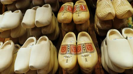 machado : Zaanse Schans, Netherlands, May 2018: Traditional wooden shoes in the Netherlands - klompen. Beautifully decorated with mills. Gift shop
