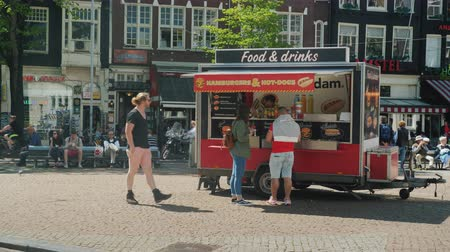 fries : Amesterdam, Netherlands, May 2018: A street van with fast food on Amsterdam Street. Tourists and locals buy snacks