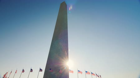 president of united states : Static shot: Sunlight shines because of the Washington Monument, DC.