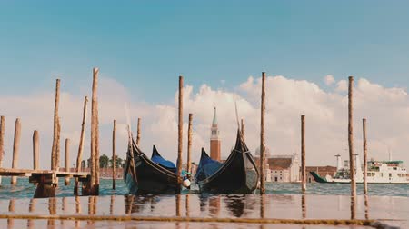 Венеция : The famous gondolas of Venice. In the foreground, waves are broken. Holiday in Italy Стоковые видеозаписи
