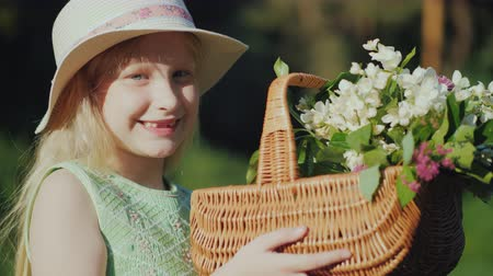 košíček : Portrait of a fair-haired girl of seven years with a basket of wildflowers