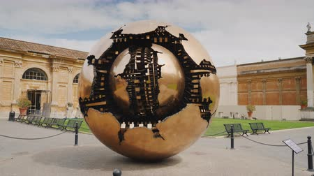 vatikan : ROME, ITALY, VATICAN - JUNE, 2017: The Sphere within a Sphere, a bronze sculpture. Steadicam shot