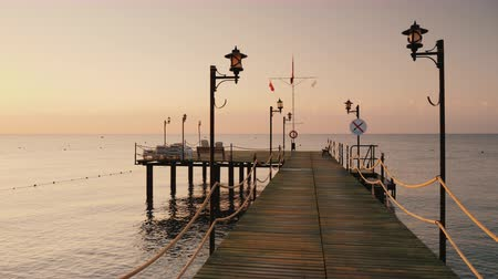 계선 : Walk on the pier to the sea, a first-person view. Earlier morning at sunrise