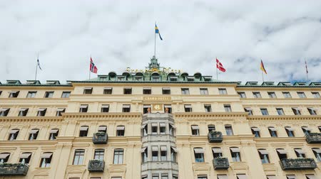 nobel : Stockholm, Sweden, July 2018: Beautiful building of the Grand Hotel in Stockholm, Sweden. Here rest the Nobel Prize winners Stock Footage