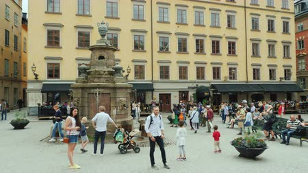 İsveççe : Stockholm, Sweden, July 2018: The square of the old city in the center of Gamla Stan. Many tourists rest here and admire the beautiful architecture