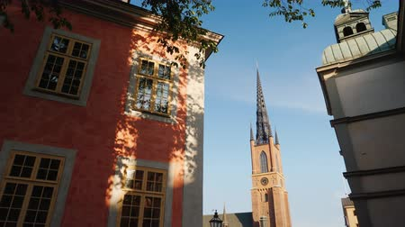 stockholm : View of the famous church with an metal spire in Stockholm - Riddarholmen Church. Steadicam shot