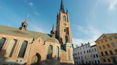 worship : Tilt shot: Famous church with an metal spire in Stockholm - Riddarholmen Church.
