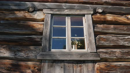 cinematic : Window with flowers on a windowsill in an old wooden house Stock Footage