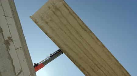 planking : A large reinforced concrete slab hangs on the boom of the crane. Dangerous profession concepts Stock Footage