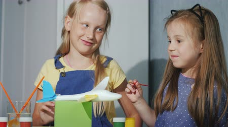 гуашь : Children have fun together, paint a model of the plane, laugh. Educational games dyal children Стоковые видеозаписи