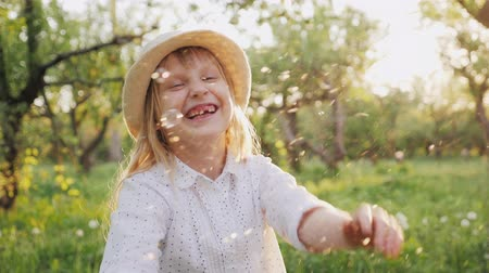 spring breeze : Happy child playing with soap bubbles, laughing. Slow motion video