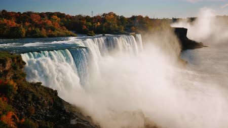 at nalı : Fall at Niagara Falls. Aerial view of one of the most popular tourist destinations in the US Stok Video