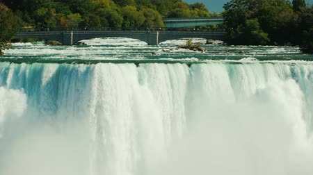 smashing : The powerful water flow of Niagara Falls and the bridge over the Niagara River
