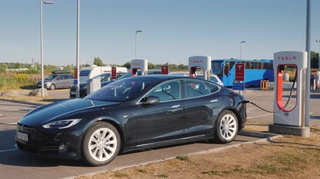 socket : Lillehammer, Norway, July 2018: Black car brand Tesla is charged on the branded free fast charging station
