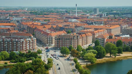 danimarka : View of the city of Copenhagen from above. Neat houses and a busy road with traffic cars