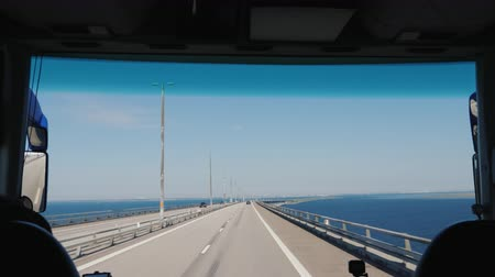 fix : Copenhagen, Denmark, July 2018: View from the windshield of the bus -Drive along the Oresund bridge between Denmark and Sweden