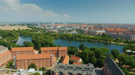 copenhagen : Beautiful city of Copenhagen, view from the heights. Houses with tiled roofs and a river. Pan shot