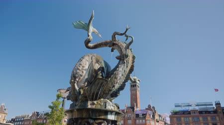 frightful : Copenhagen, Denmark, July 2018: Fountain Bull rent the Dragon in the center of Copenhagen near the town hall