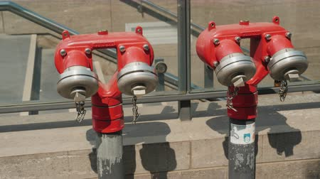 blasting : Berlin, Germany, May 2018: Red fire hydrant near the underground passage in Berlin