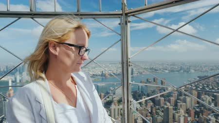observation deck : Portrait of a young woman admiring a beautiful view of the city of New York