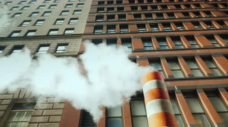 füstös : Pipe with excess steam from the steam system of New York. Bright orange striped - one of the symbols of Manhattan and New York