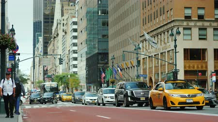 ave : New York, USA, September 2018: Traffic cars on the luxurious Madison Avenue in New York