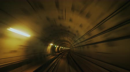 danimarka : Fast ride in the subway tunnel, first-person view. Movement in the tunnel causes a hypnotic effect. Stok Video