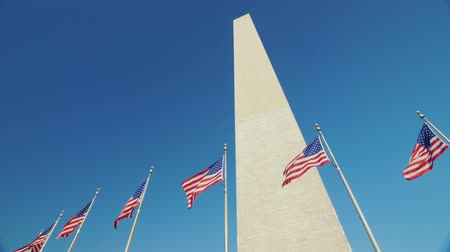 obelisk : Washington Monument in the background of a clear blue sky Stock Footage