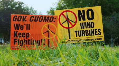 áttekinthetőség : Wilson, NY, USA, September 2017: Poster with agitation against wind turbines. People are outraged by the proximity and size of wind generators
