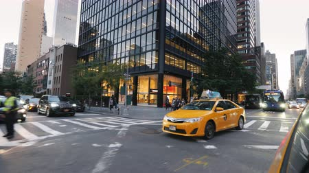 times : New York, USA, September 2018: Famous yellow taxis ride along the streets of Manhattan Stock Footage