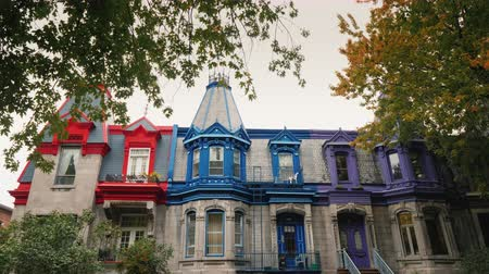 pinion : Colorful Victorian Houses in Square Saint Louis - Montreal, Quebec, Canada. Beautiful multi-colored roofs