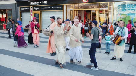 chant : Stockholm, Sweden, July 2018: The Hare Krishna group plays musical instruments, sings and dances on the streets of Stockholm