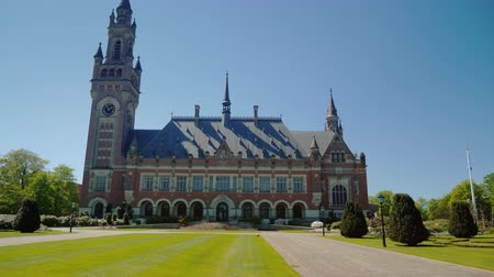 relógio : Hague,Netherlands, May 2018: The Peace Palace in The Hague, where the seat of the International Court of Justice is located