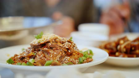 ヌードル : A close-up of eating authentic Chinese food with chopsticks. Chinese Restaurant and Food Concept