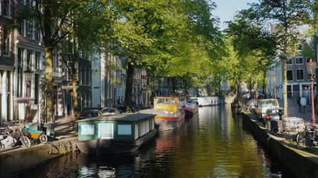 Amsterdams picturesque cityscape overlooking the cozy canal. Tourism in the Netherlands