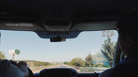 inside bus : Antalya, Turkey, July 2019: View from the front window of the bus to the road to Antalya International Airport