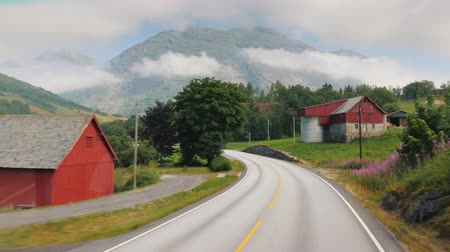 planalto : Drive along the handsome road among the mountains of Norway. Pov view from the bus window