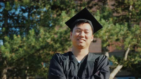 diploma : Asian young man in graduate clothes. College graduation concept