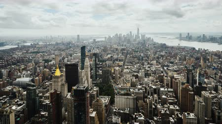 Panning timelapse video of the business district of Manhattan in New York. Aerial view
