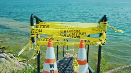 Flooded Pier Entrance with Warning Tape
