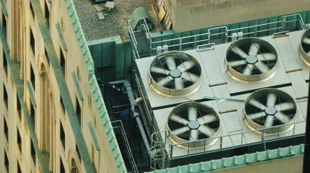 air pump : Air conditioning and ventilation fans of a high-rise building on the roof Stock Footage
