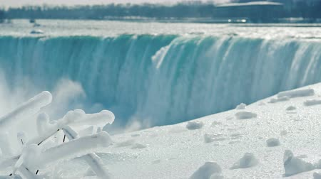 at nalı : Winter at Niagara Falls, snow and ice glistens in the sun Stok Video