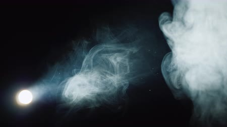 aimed : Lantern illuminates smoke on a black background Stock Footage