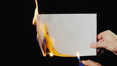zapalovač : A man burns an unopened letter