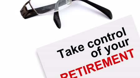 retirement : animation of paper with writing words take control of your retirement and glasses in ae cs5 Stock Footage