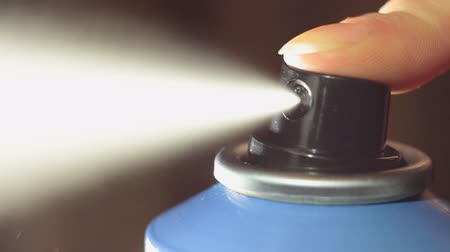 pulverização : Aerosol Sprayed from the Spray. The deodorant sprayed from the container. Small splashes. Stock Footage