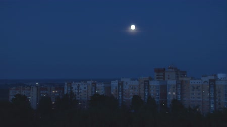 Moon Moves over City. The moon moves in the night